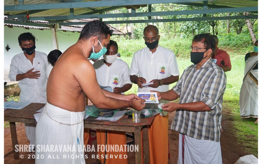 Distribution of groceries and vegetables and financial aid to needy at Edathanattukara