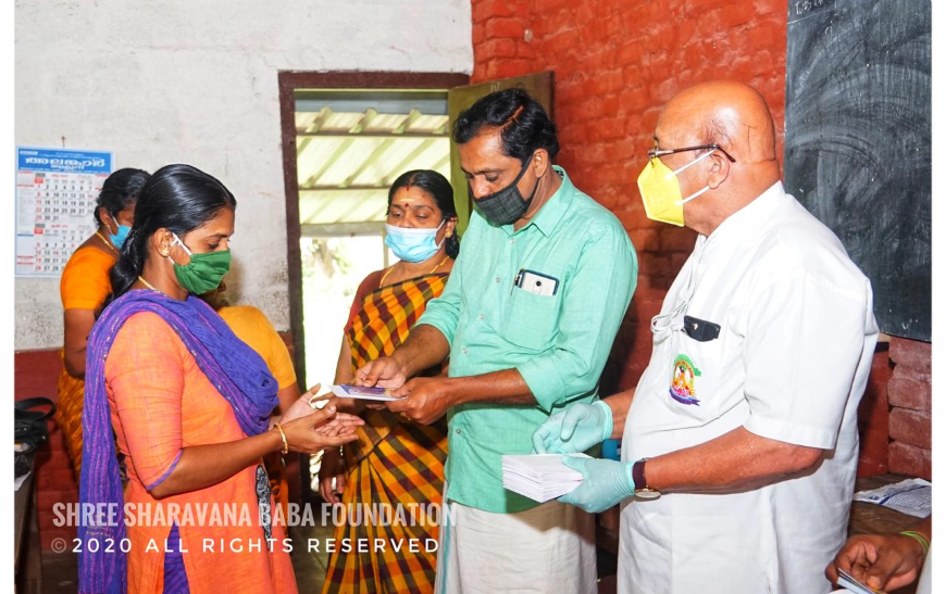 Distribution of groceries and vegetables and financial aid to needy at Karimpuzha