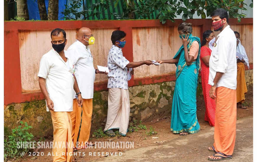 Distribution of groceries and vegetables and financial aid to needy at Kanjirapuzha