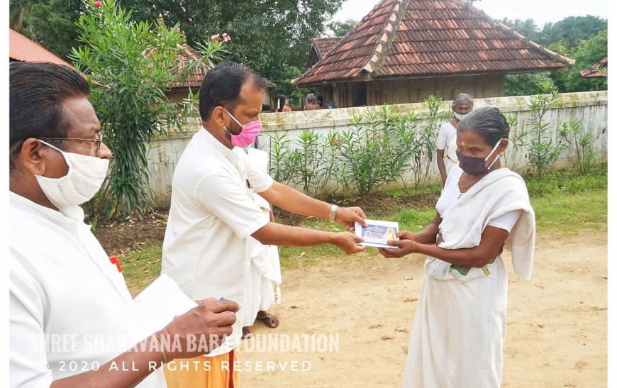 Distribution of groceries and vegetables and financial aid to needy at Pathiripala