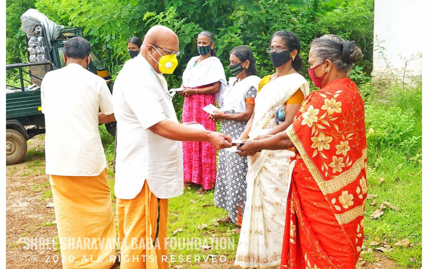 Distribution of groceries and vegetables and financial aid to needy at Palakkad